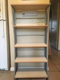 5 shelve wood and steel on wheels can be used in a pantry or closet White Lake, 48383