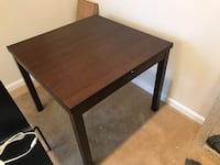 Ikea brown dining table, four seats.  Fairfax, 22031