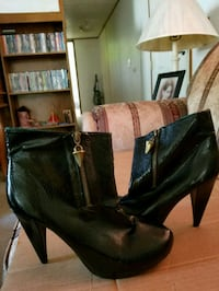 pair of black leather heeled boots Lexington