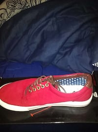 unpaired red low top sneakers Columbus