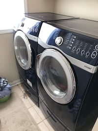black front-load clothes washer and dryer set 535 km