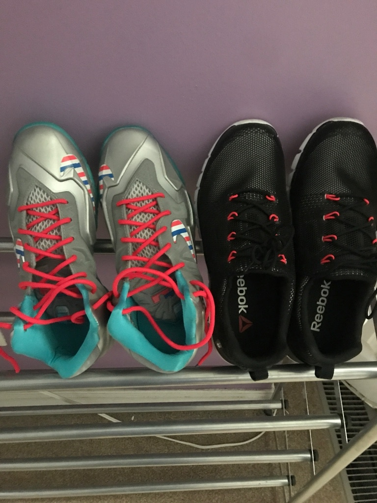Photo Pair of black-and-pink nike / reebok running shoes