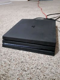 Ps4 pro 1tb, 2 controllers, 8 games Calgary