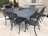Cast iron patio set with 8 chairs in good condition always covered in winter months.  Vaughan, L6A 1E8