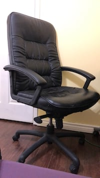 black leather padded rolling armchair Mississauga