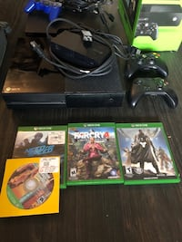 black Xbox One console with controller and game cases Washington, 20024