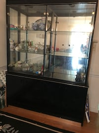 China Hutch-Black,  mirrored back w/glass shelves. This is in excellent condition and would look great in your home. Mount Airy, 21771