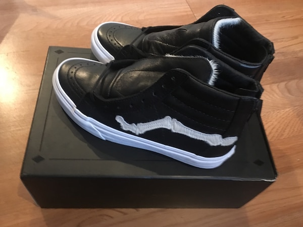 Pair of white-and-black vans sk8-hi with box
