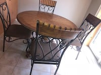 round brown wooden table with four chairs Vaughan, L6A 3N4