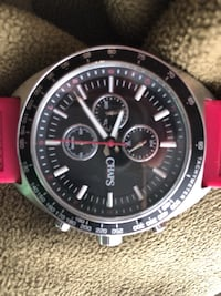round silver-colored chronograph watch with red strap 551 km