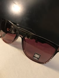 PUGS brand sunglasses with UV400 protection lenses. Lens frames are black on top and then have a marble design towards the bottom of the frames. No scratches at all! Brand new, in perfect condition.  Louisville, 40299