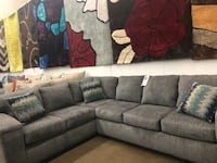 Fabric sectional with accent pillows. Brand new.