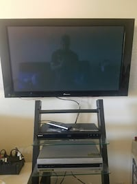 black metal framed television stand and Pioneer fl