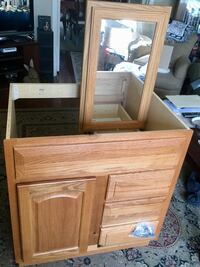 Oak finished vanity with matching medicine cabinet