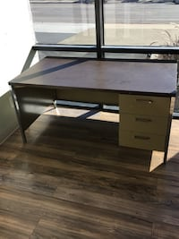 Brown and gray wooden and metal desk