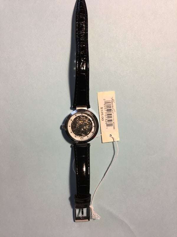 Ladies Kenneth Cole watch with black wristband. 4f791b96-e317-4c8b-84be-f82a59d4e3f1