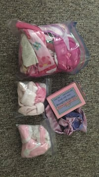Baby bibs hats and socks all mint condition  Kitchener, N2A 1B2