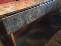 Brown marble surface table with bench seats