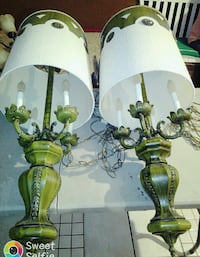 two green table lamp bases with white lampshades