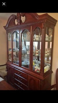brown wooden framed glass china cabinet Edmonton, T6X