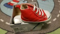 pair of red leather low top sneakers Vancouver, V6J 1P7