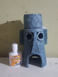 BIC wite-out bottle and gray concrete tribal mask fish tank accessory Milton, L9T 1V4