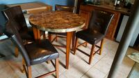 round brown wooden table with four chairs dining s Carmel Hamlet, 10512