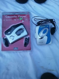 two black and white bluetooth earpiece Pensacola