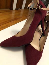 pair of red suede heeled shoes