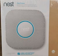 white and blue Nest learning thermostat box