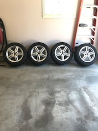 Porsche Cayenne wheel and tire set. Tires have 30% tread left. Wheels are immaculate!!! Lexington, 40515