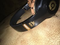 Black and gold Beats By Dr. Dre collab MCM cordless headphones