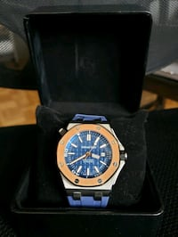 round gold-colored chronograph watch with link bracelet 548 km