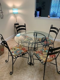 Wrought Iron dinnete glass table & 4 chairs