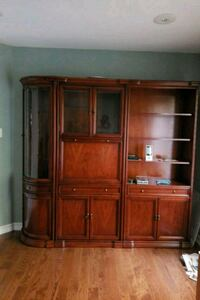 brown wooden TV hutch with flat screen television Mississauga, L5M 5V6