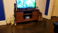 flat screen TV and brown wooden TV stand Washington, 20017