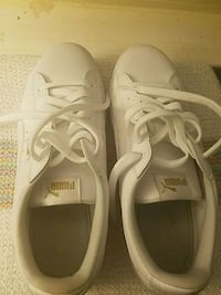 pair of white Puma low top sneakers Bristow