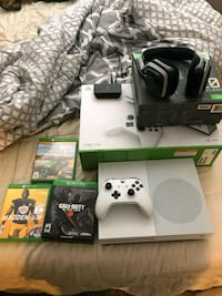 white Xbox One console with controller and game cases Ogden, 84404