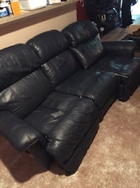 Dark blue leather padded recliner sofa