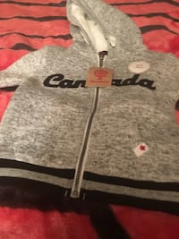 gray and black Canada zip-up hoodie