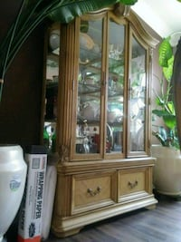brown wooden framed glass display cabinet Albuquerque, 87121