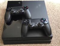 black Sony PS4 console with two controllers