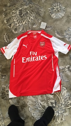 red and white Fly Emirates Puma jersey