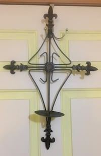 Black metal wall mount candle holder