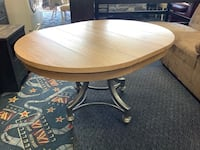 New Round Sagvenay Extendable Dining Table