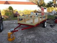 red and white utility trailer