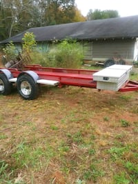 red and white utility trailer 385 mi