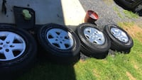 2015 Jeep Wrangler wheels and tires. Set of 5 wheels and 4 tires