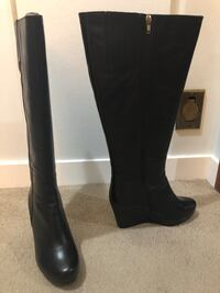 pair of black leather knee high boots Edmonton, T6K 0A1