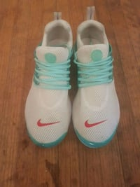 pair of white-and-teal Nike basketball shoes Maple Ridge, V2X 5R2